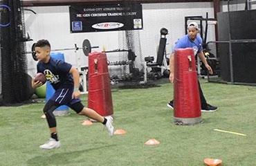We offer Running Back Classes for all levels of athletes playing youth, middle school and high school football and even offer Personal 1-on-1 sessions for even more advanced training. We offer two classes on Tuesday Nights and Saturday Afternoon which allow for beginners, intermediate and advanced athletes looking to get better at the running back position and running with the football. Let's think about it... if you play offense and can touch the football, you should be taking one of these classes. If you are a Quarterback and asked to run with the ball, you become a Running Back... if you are a Wide-Receiver, after you catch the ball, you become a Running Back.  For this reason we have separated our Running Back classes into two different age groups and offer these classes on Tuesdays and Saturday  to allow maximum effort for those attending the classes.  Our Intro/Intermediate youth class is scaled back and works on introducing athletes to the position. Our advanced/elite class is focused on building and training to be a better ball carrier.  We offer these classes twice per week on Tuesday Nights and Saturdays.