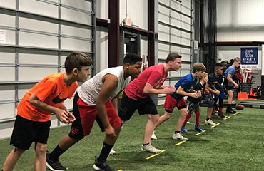 Wide Receiver Football Training focuses on the techniques needed to play any position that catches the football. This class is highly recommend for all running backs along with wide receivers as this class allows athletes to work on their pass catching techniques and fundamentals. We work every class on an athlete's stance then progress into get offs and using a move to get open.  This class is highly recommended for any youth player looking to be successful catching the football on offense.